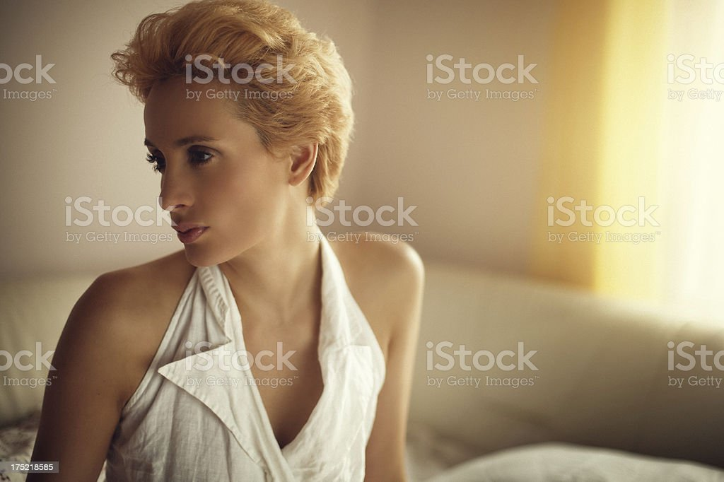 young woman sitting in bed royalty-free stock photo