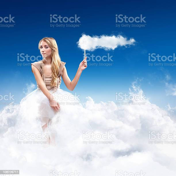 Photo of Young Woman Sitting in the Sky on Clouds