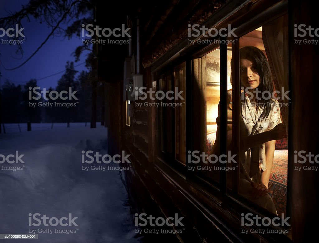 Young woman sitting in window royalty-free stock photo