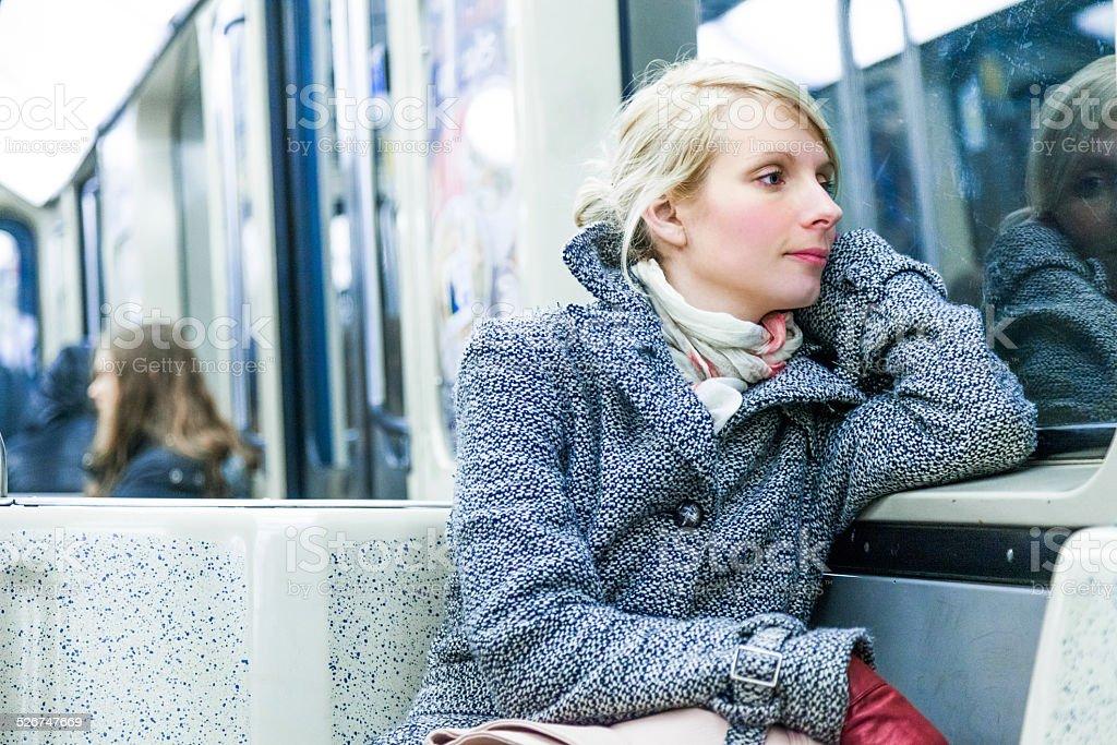 Young Woman Sitting inside a Metro Wagon stock photo