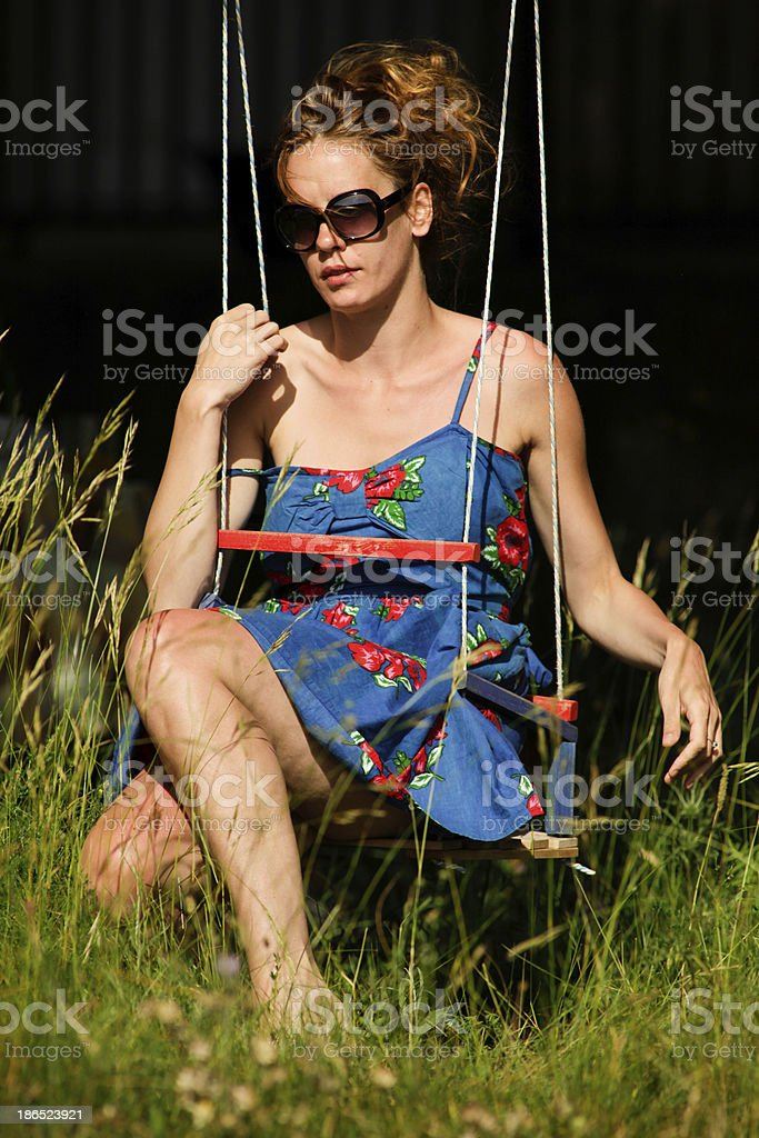 Young woman Sitting on Swings royalty-free stock photo