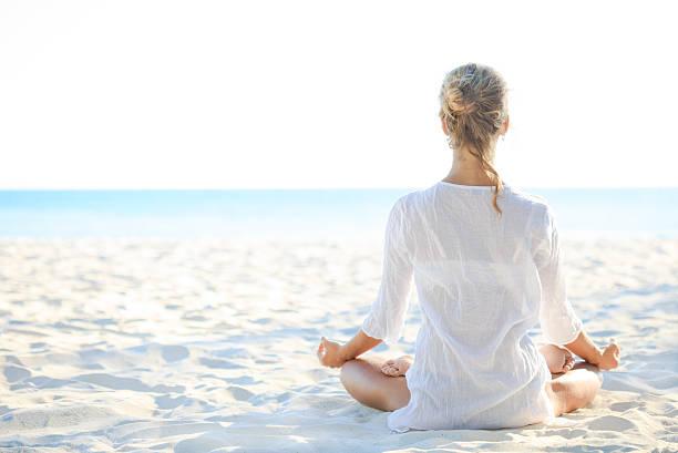 Young woman sitting on the beach and meditating picture id519009420?b=1&k=6&m=519009420&s=612x612&w=0&h=rz85gn9vx1mkhva2r7llvouvf8fsqgyqtu2hu0hok c=