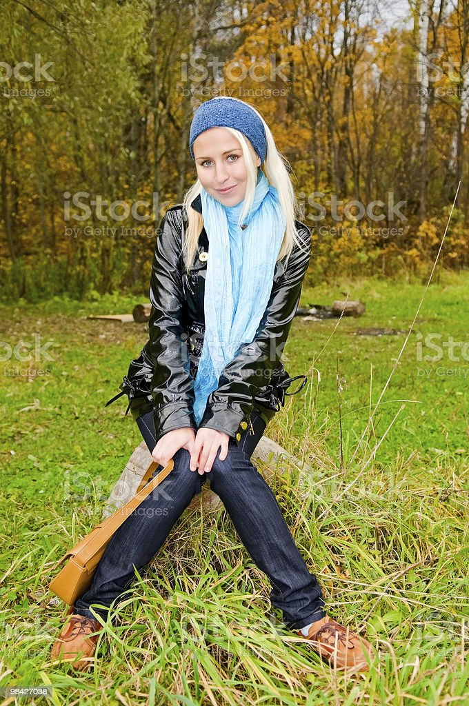 young woman sitting on the rock in forest royalty-free stock photo