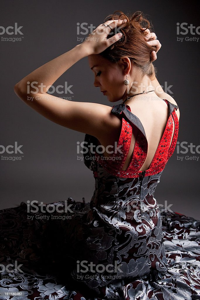 young woman sitting with lifted hands royalty-free stock photo