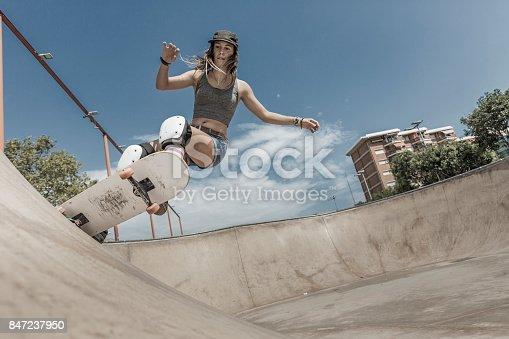 Young woman skateboarding in Barcelona Catalonia Spain