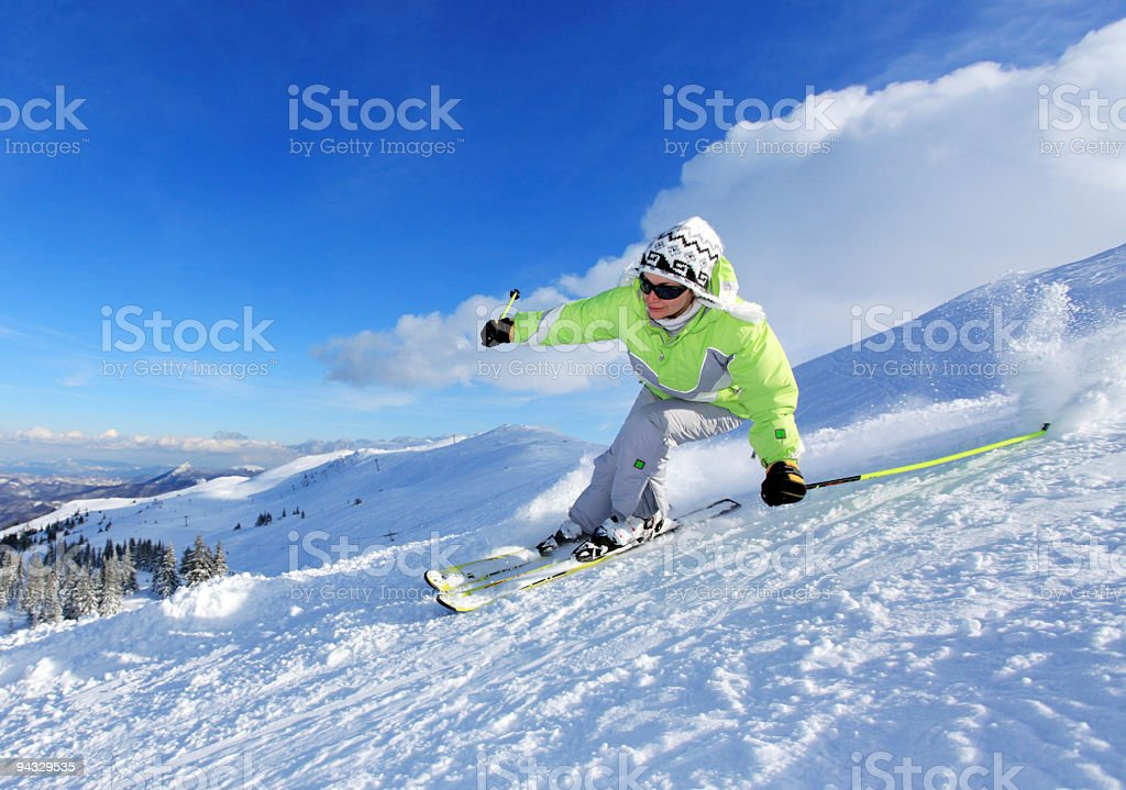 Young woman skiing on the mountains royalty-free stock photo