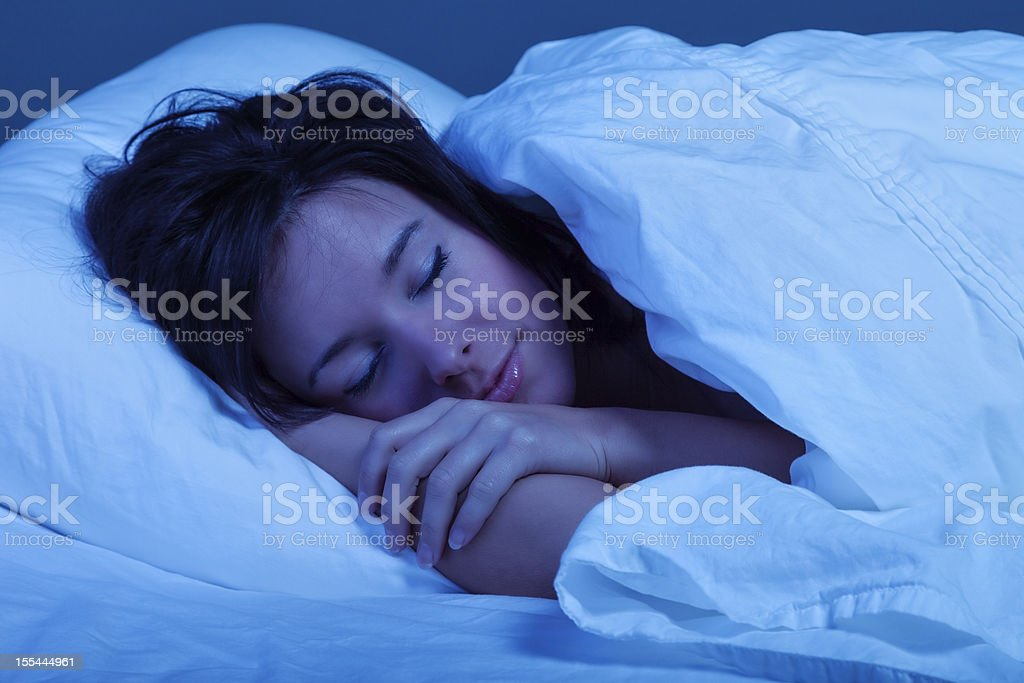 Young Woman Sleeping Blissfully stock photo