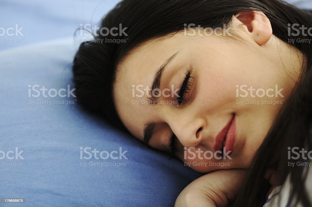 Young woman sleeping on bed royalty-free stock photo