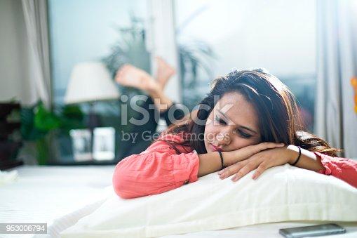 istock Young woman sleeping 953006794