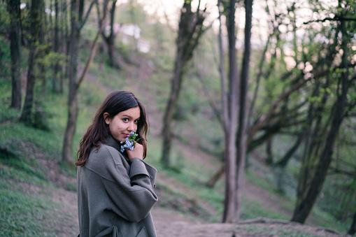 She walks through dense forest
