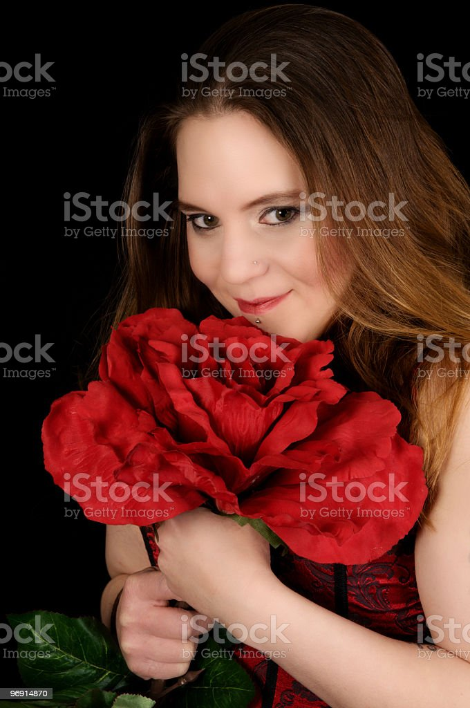 Young woman smiles over big flower. royalty-free stock photo