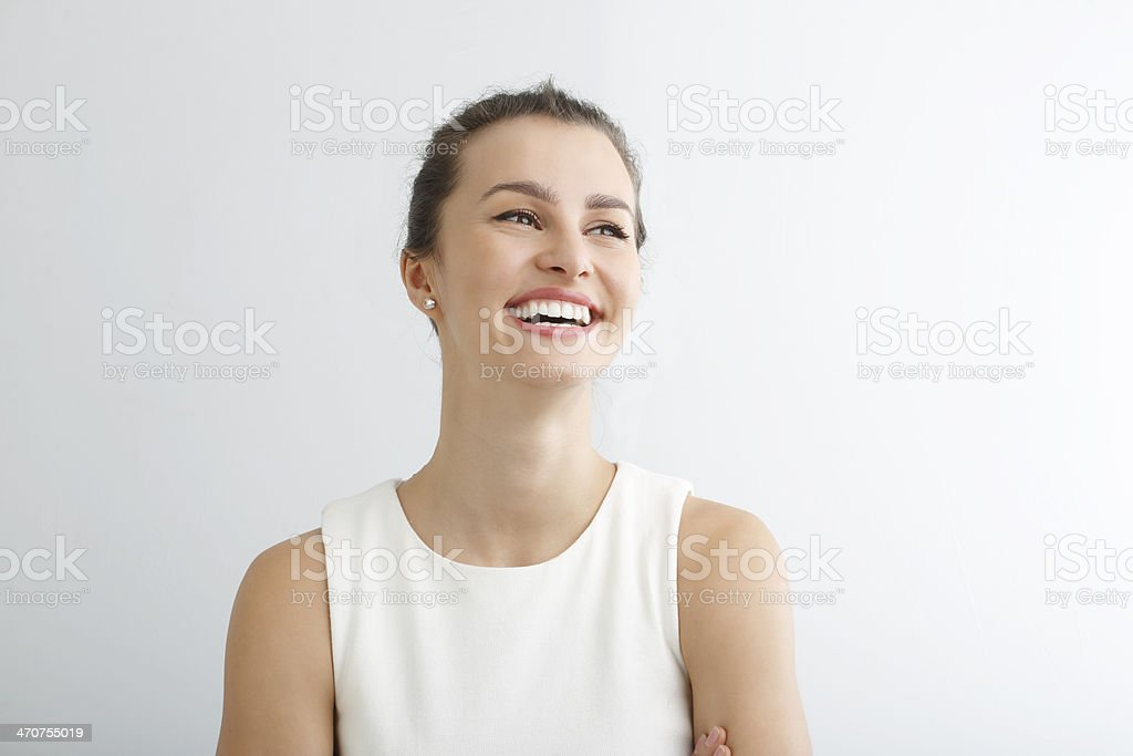 Young woman smiling against white background stock photo