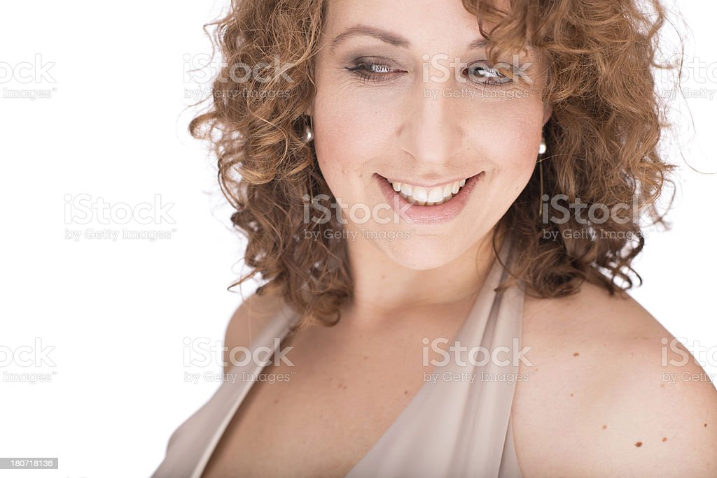 Young Woman Smiling and Looking to Side royalty-free stock photo
