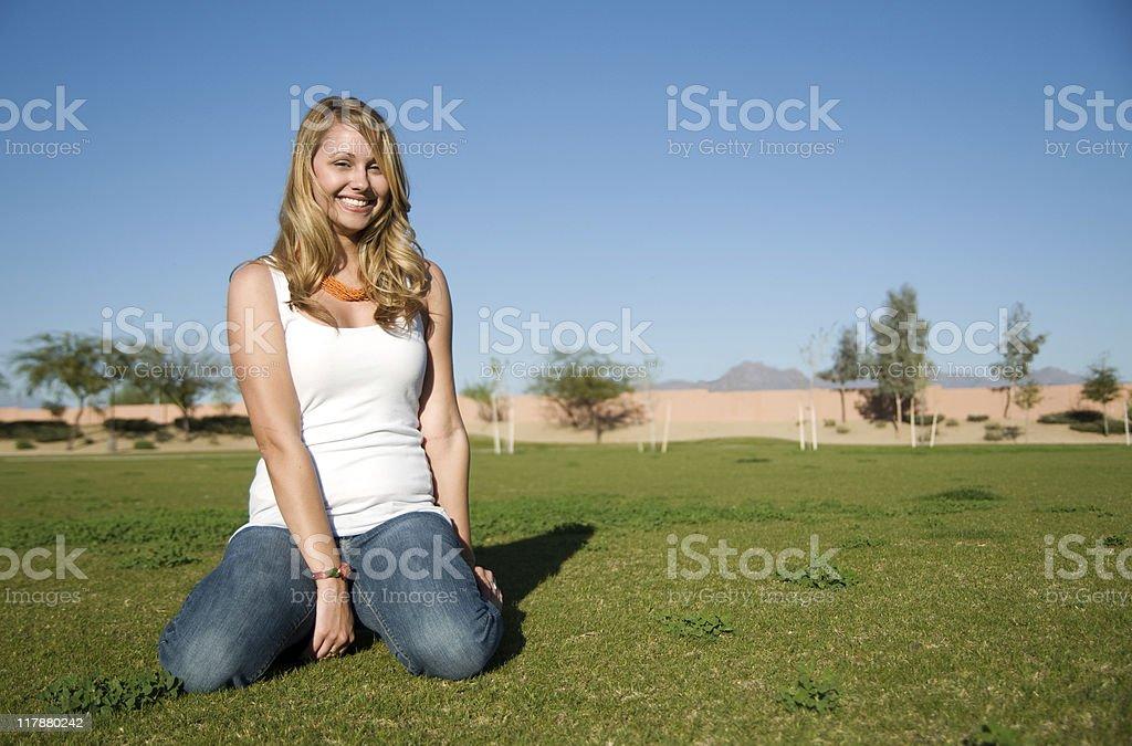 Young woman smiling at camera. stock photo