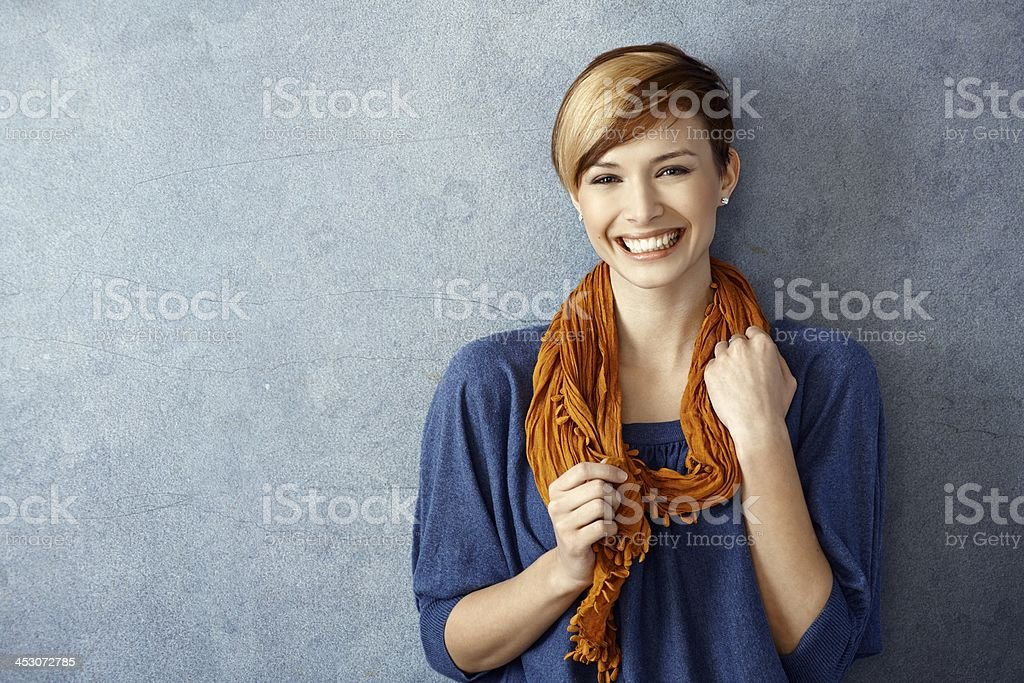 Young woman smiling happily stock photo
