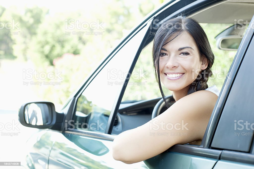 Young woman smiling in car royalty-free stock photo