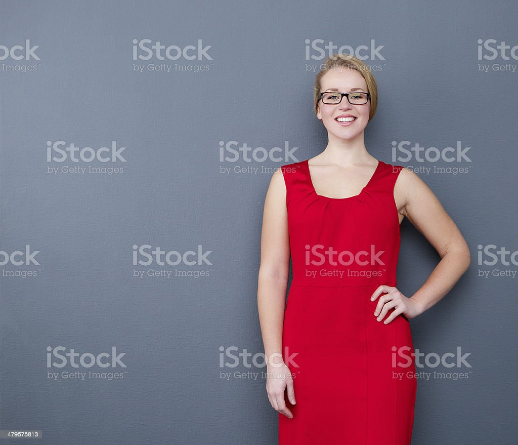 Young woman smiling in red dress stock photo
