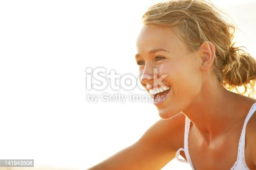 istock Young woman smiling 141943508