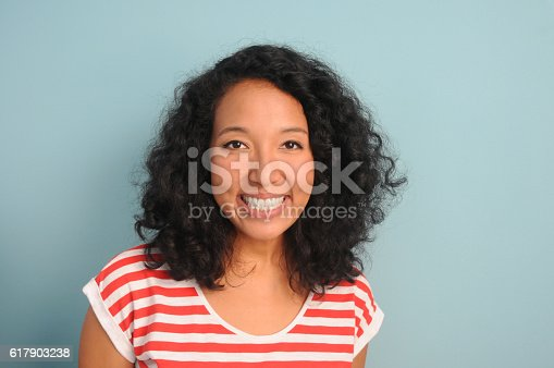 A young, mixed race woman smiling.