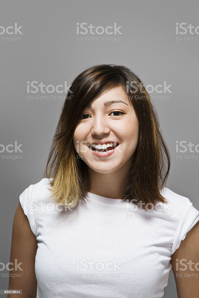 Young woman smiling royalty free stockfoto