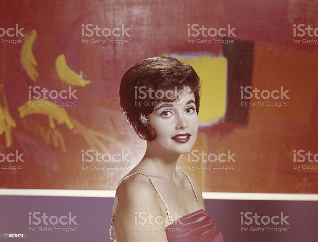 Young woman smiling, portrait, close-up stock photo