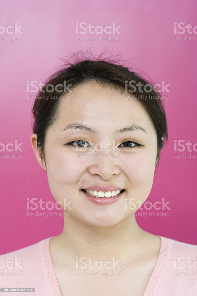 Young woman smiling, portrait, close-up royalty-free stock photo