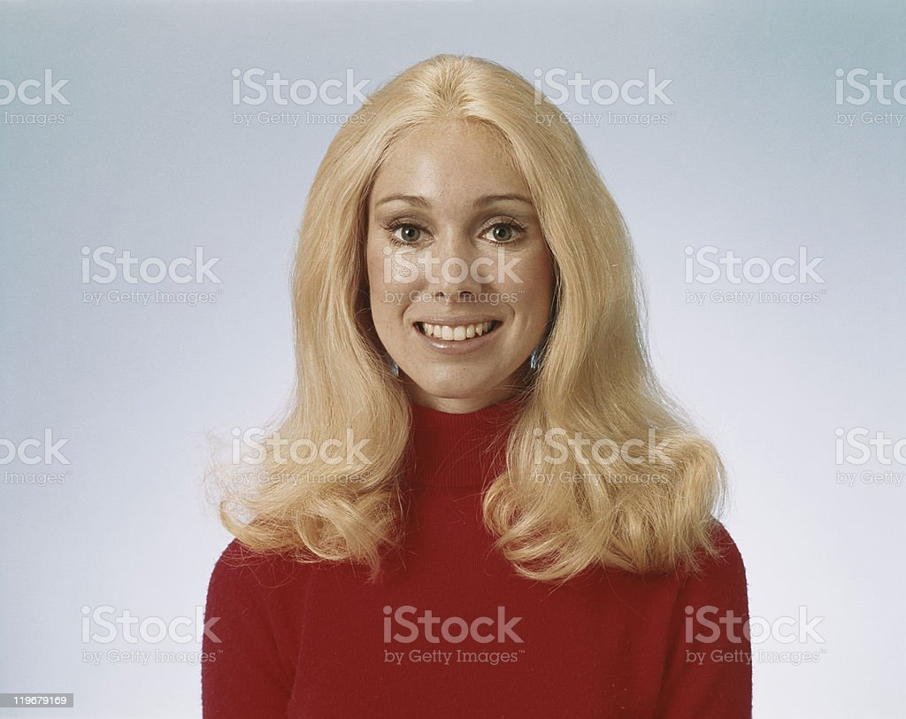 Young woman smiling, portrait stock photo