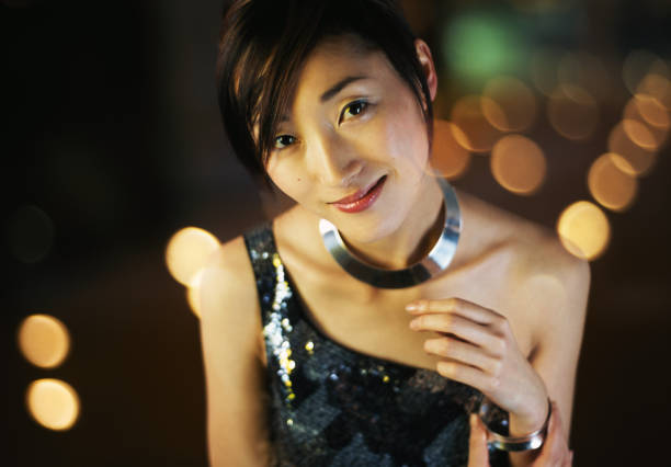 Young woman smiling, portrait (Digital Composite) Young woman smiling, portrait in blurred lights.(Digital Composite) evening wear stock pictures, royalty-free photos & images