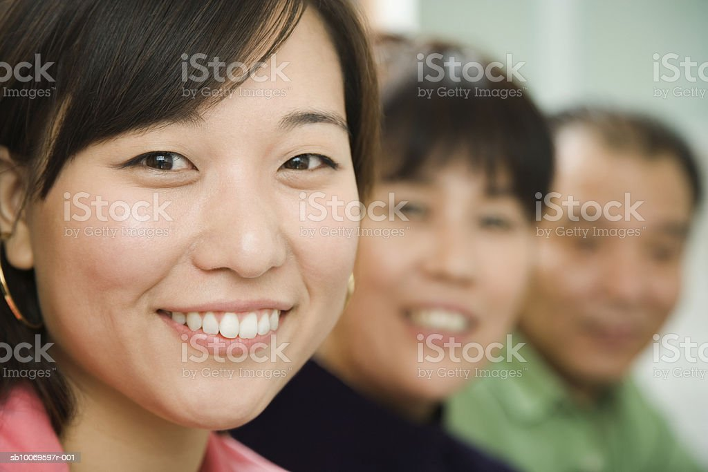 Young woman smiling, portrait royalty free stockfoto