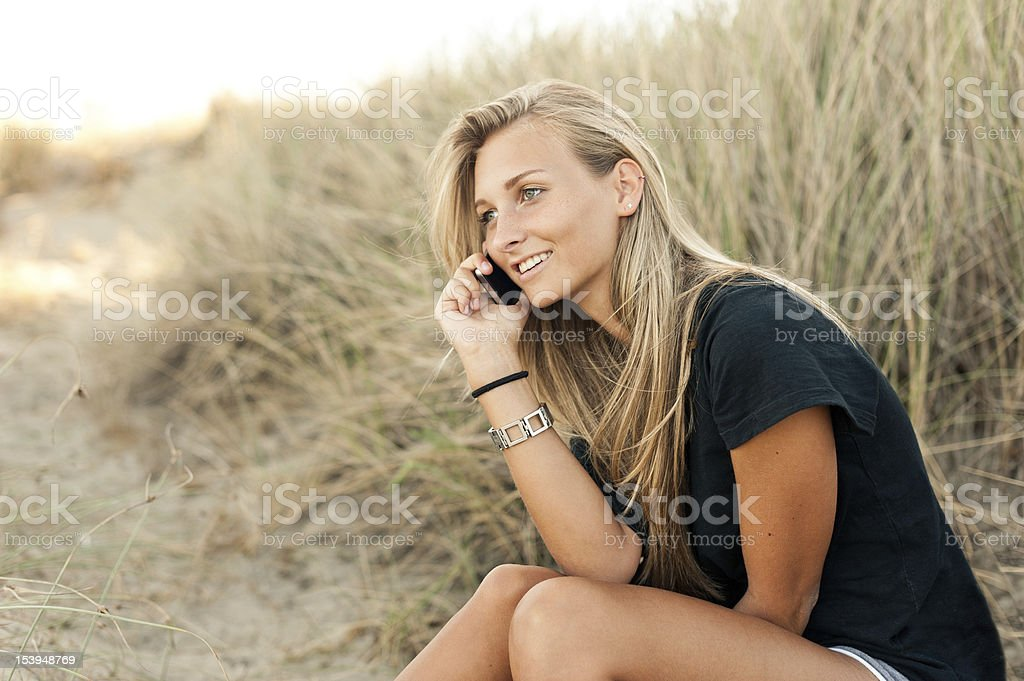 Young woman smiling while is calling with smartphone royalty-free stock photo