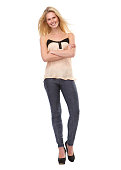 istock Young woman smiling with arms crossed 494485789