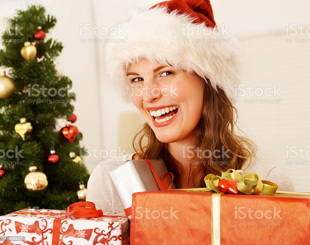 Young Woman Smiling With Christmas Gifts Stock Photo & More Pictures ...