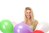 istock Young woman smiling with colorful balloons 490201387