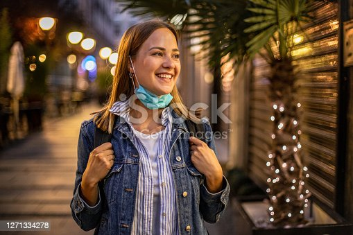 istock Young woman smiling with mask during holidays 1271334278