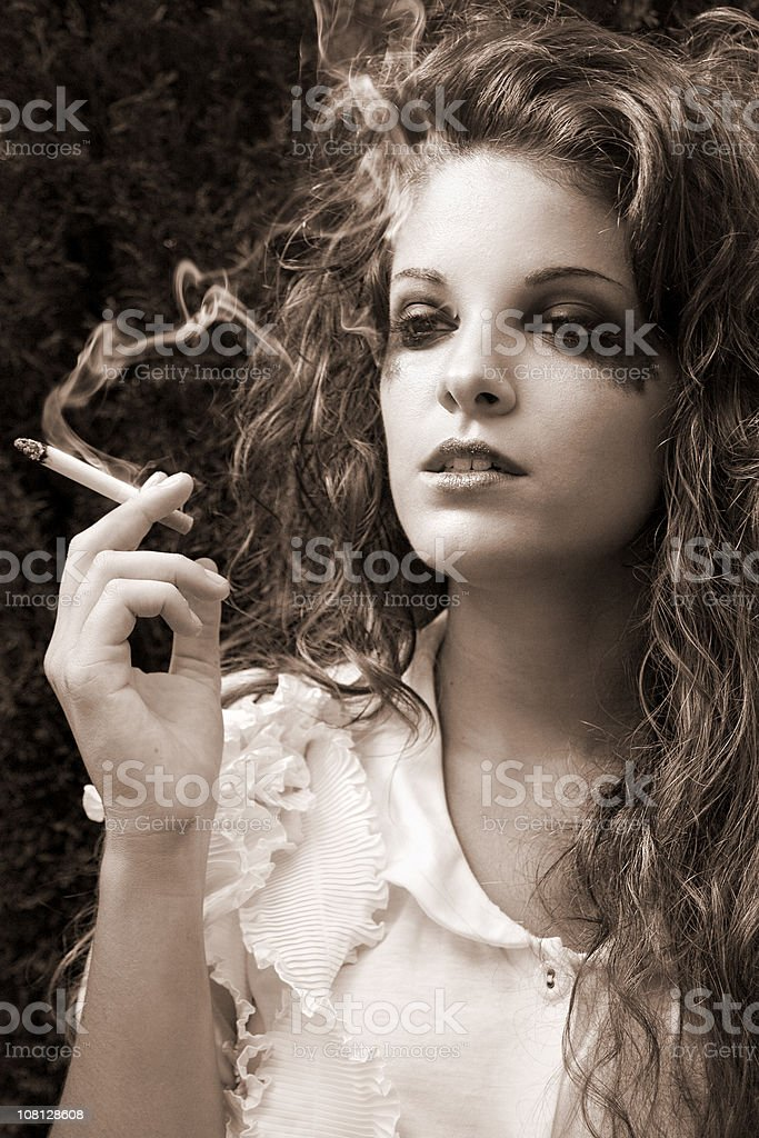 Young Woman Smoking and Make-up Smudged on Face royalty-free stock photo