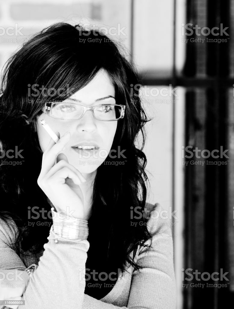 Young Woman Smoking cigarette. Black and White royalty-free stock photo