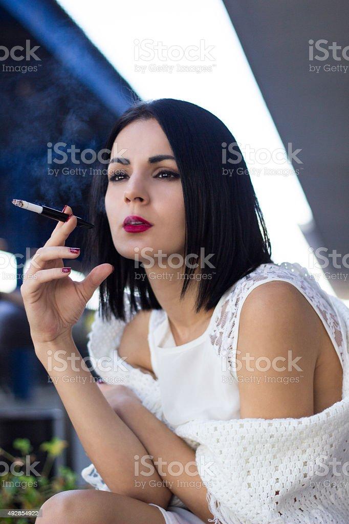 Young woman smoking cigarette stock photo