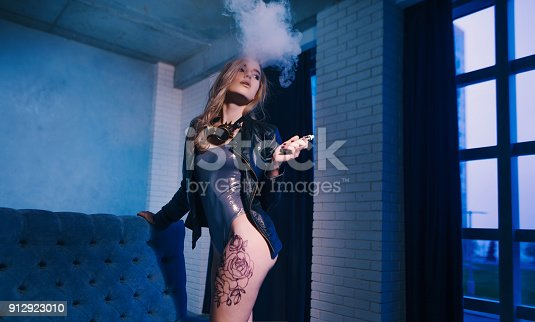 istock young woman smoking electronic cigarette 912923010