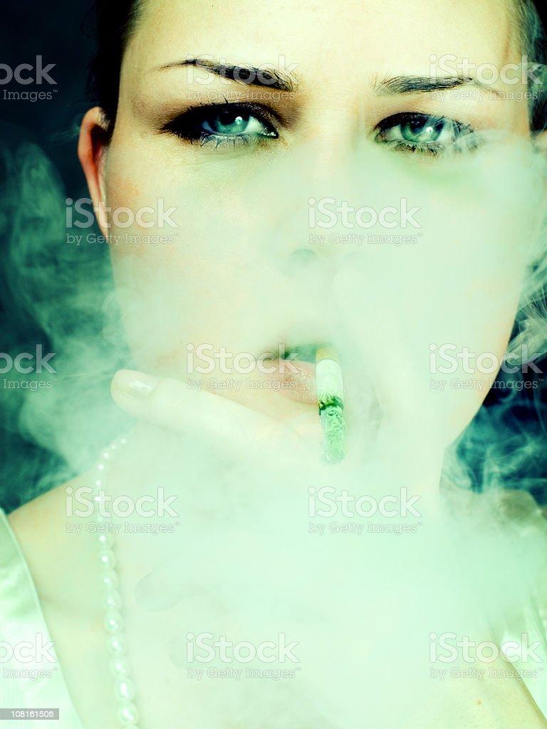 Young Woman Smoking royalty-free stock photo