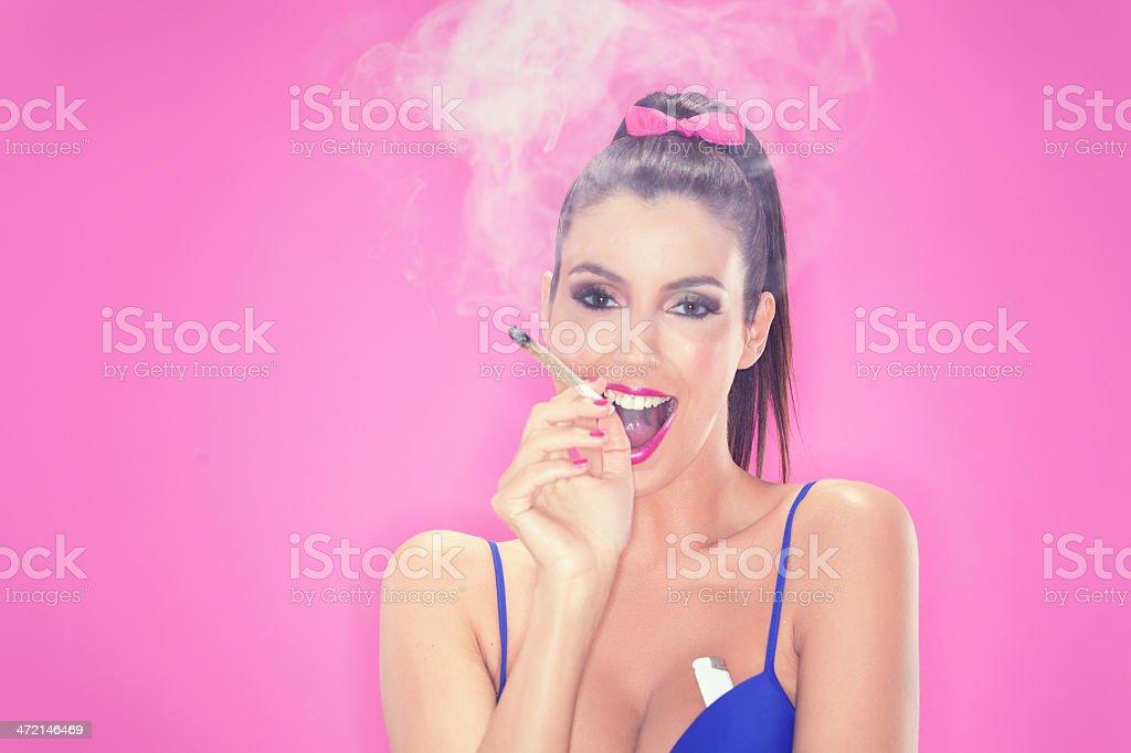 Young woman smoking weed stock photo