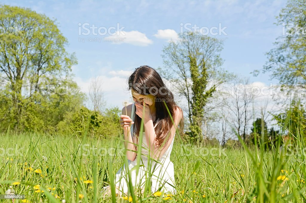 young woman sneezes stock photo