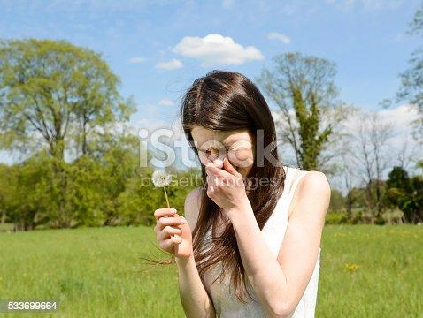 istock young woman sneezes 533699664