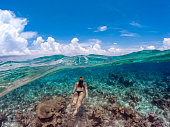 Young Woman Snorkeling in Ocean in Maldives.