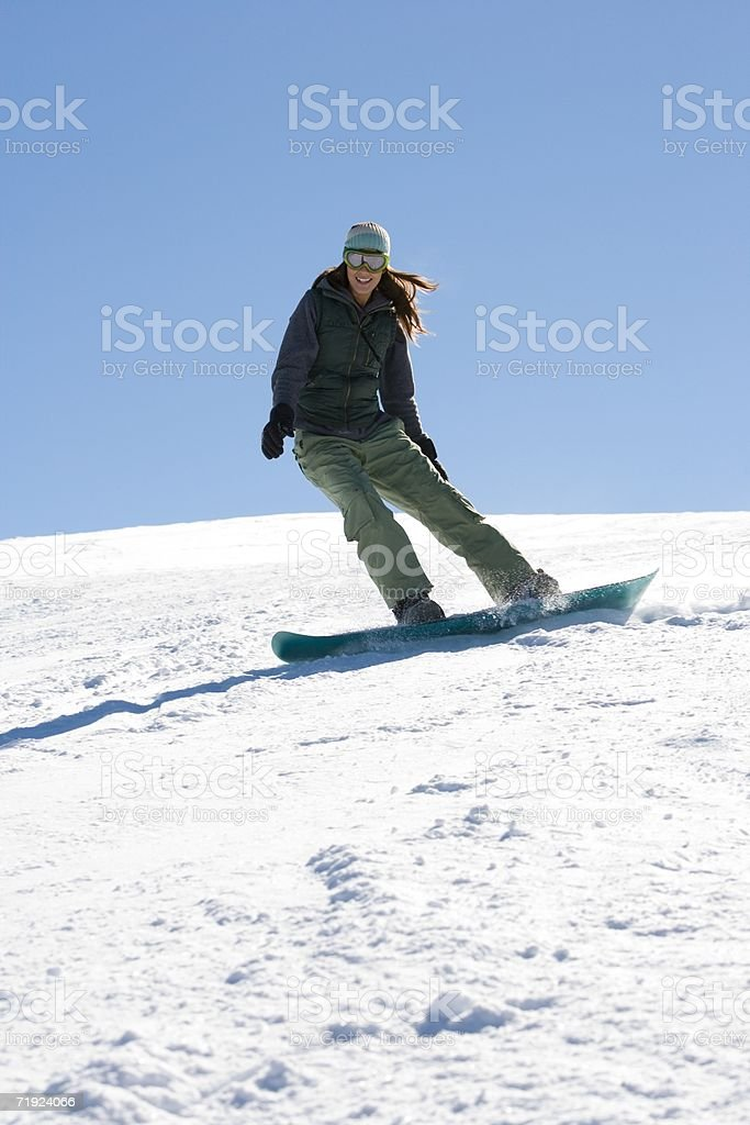 Young woman snowboarding royalty-free stock photo