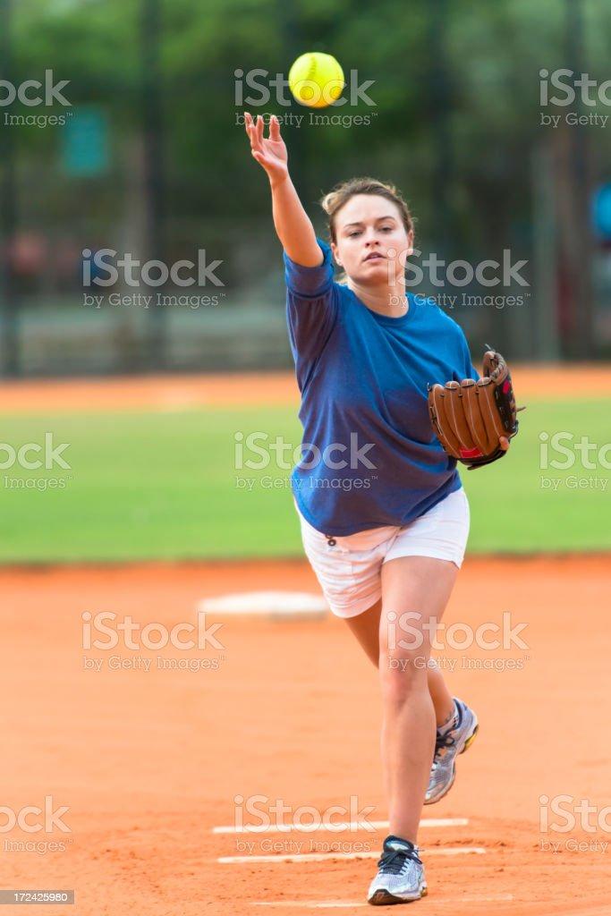 Young Woman Softball Player Pitcher Pitching Ball stock photo