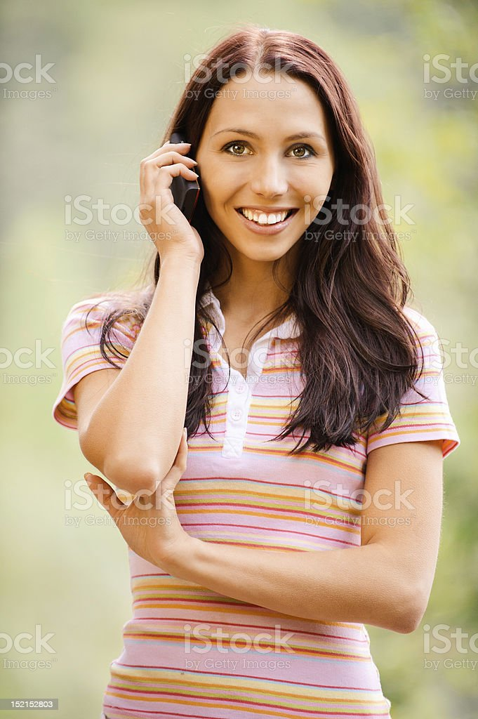 Young woman speaks by phone royalty-free stock photo