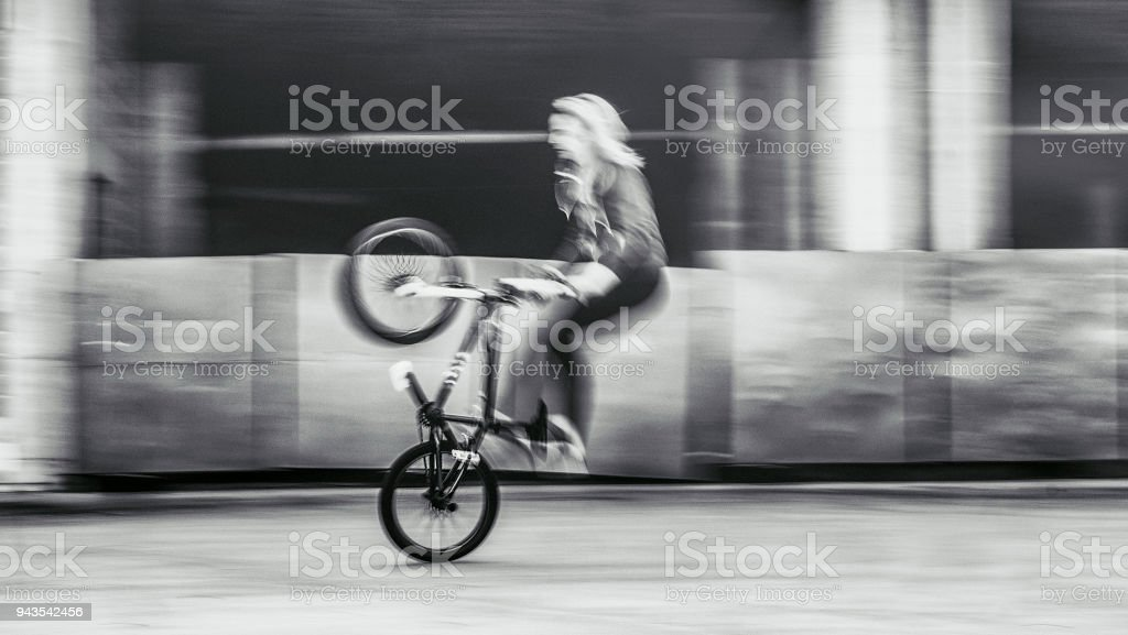 Young woman speeding with bmx bicycle.