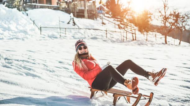 Young woman speeding with vintage sledding on snow high mountain picture id1098314764?b=1&k=6&m=1098314764&s=612x612&w=0&h=fohcwwemw7u nygkjbrw9rqappu6 ypbfxnx1bcl68u=