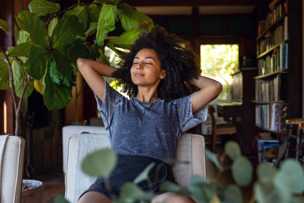 Young woman spending a relaxing day in her beautiful home Young american woman enjoy some time in her house in Los Angeles, California. tranquil scene stock pictures, royalty-free photos & images