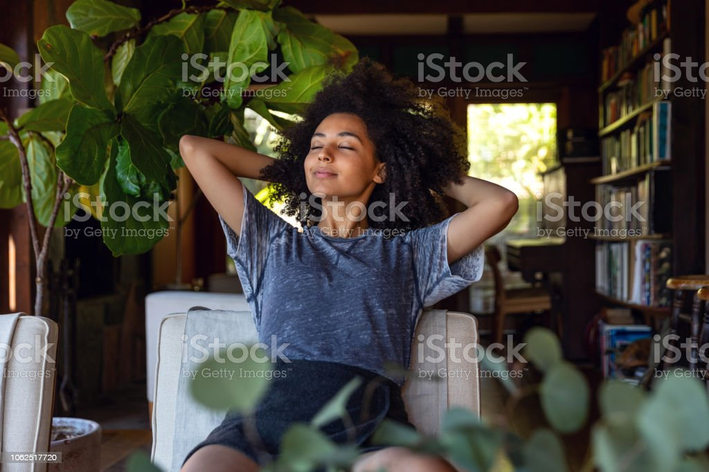 Young woman spending a relaxing day in her beautiful home stock photo